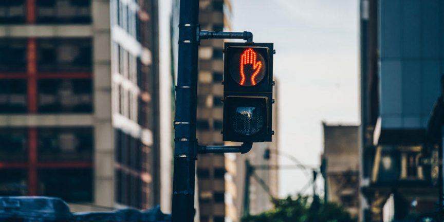 a traffic light showing a red hand