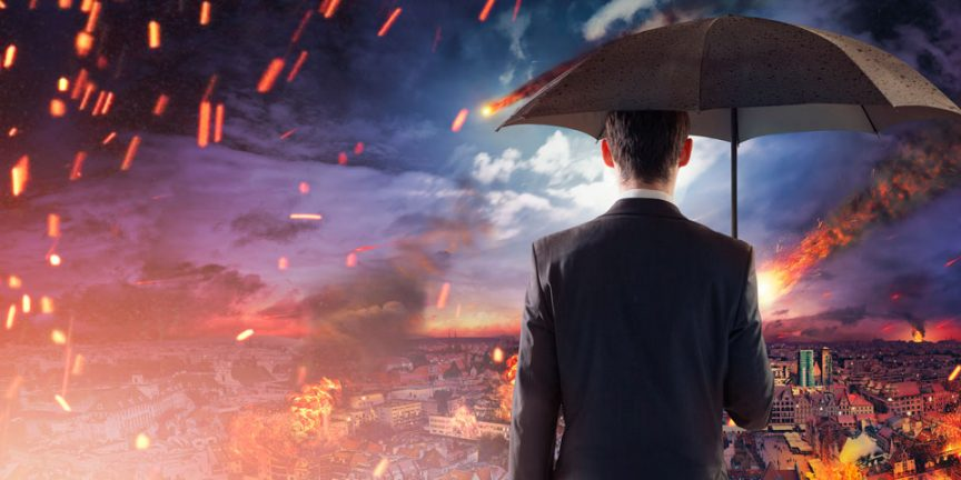 Man standing under an umbrella as fire falls from the night sky