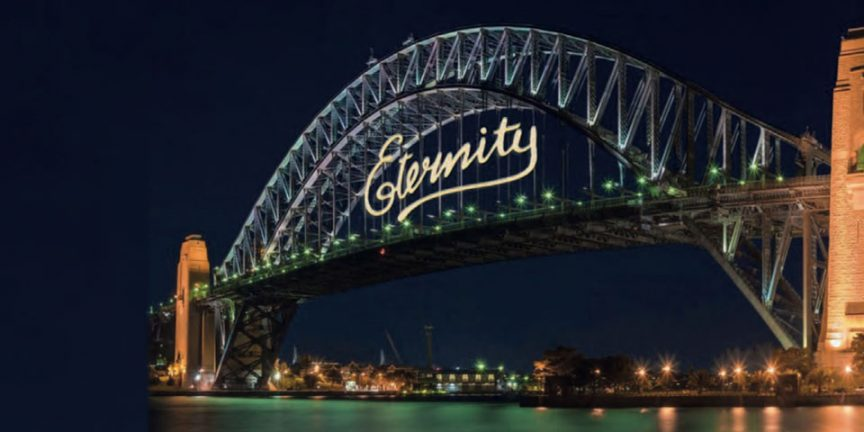 "the Sydney Harbour Bridge pictured on 1st January 2000 with the word ""eternity"" emblazoned in the centre"