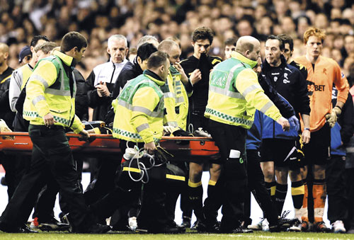 fabrice muamba being carried off the pitch on a stretcher after suffering a cardiac arrest