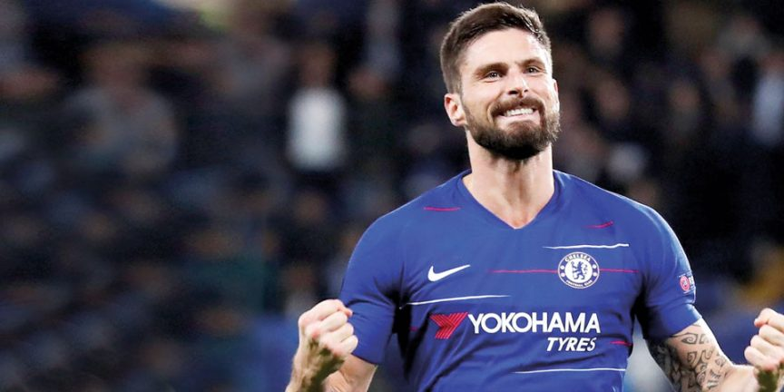 Olivier Giroud celebrating in his Chelsea football kit