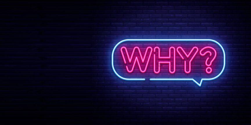 """Why"" in a speech bubble in neon lights"